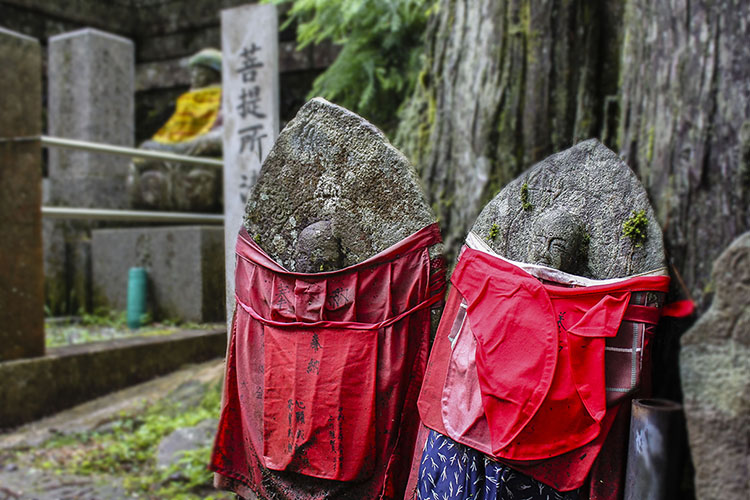 Red bibs are placed on these small Jizo buddha's when there is a child lost, in the hopes that the god will take care of the child until their parents join them in the afterlife.