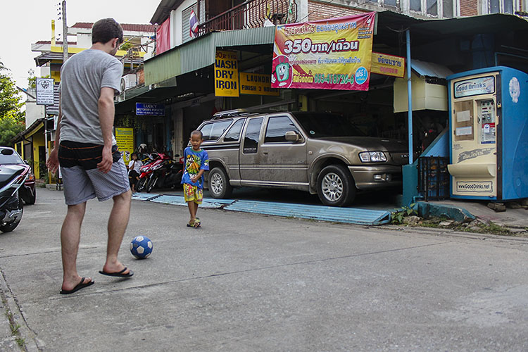 randomly playing soccer with a little thai boy in the streets