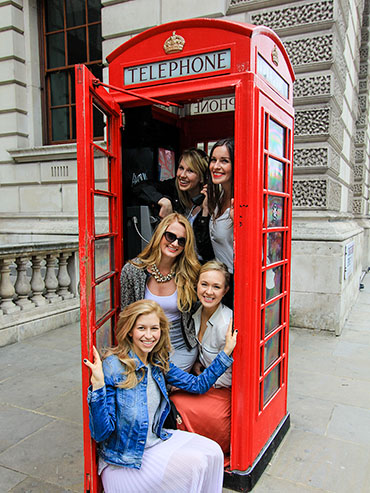 Piled into London Telephone Booth - Wanderlusters