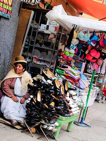 Chola Selling Shoes - La Paz Bolivia - Wanderlusters