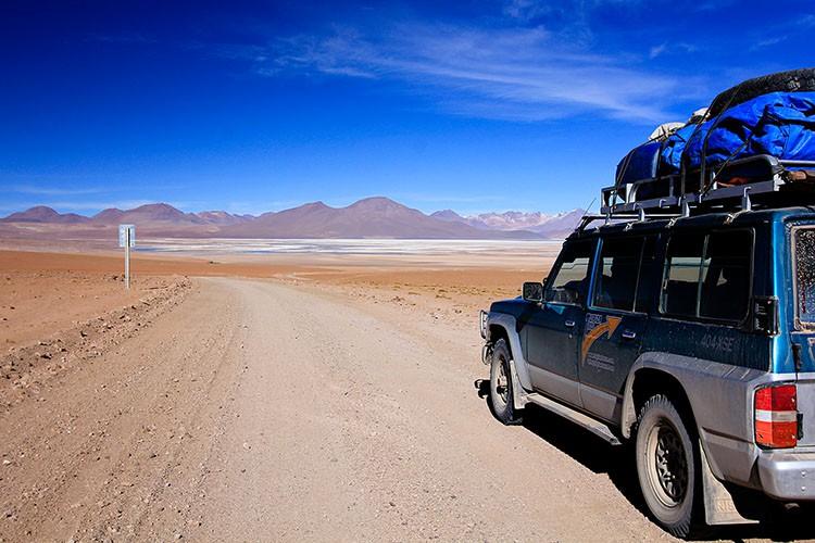 Driving Jeep Through Desert - Bolivia Salt Flats Tour - Wanderlusters