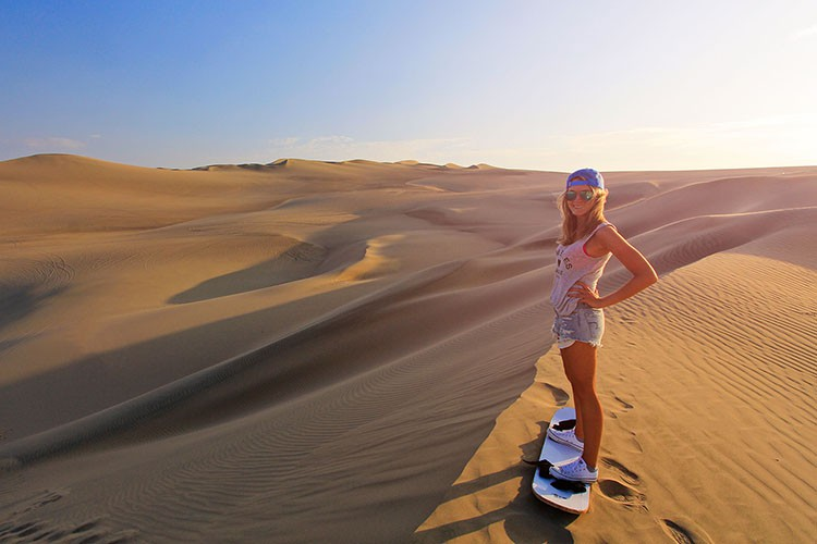 Huacachina Preparing to Sandboard - Peru - Wanderlusters