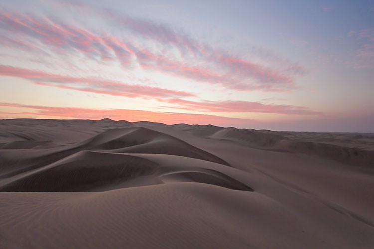 Huacachina Sand Dunes at Sunset - Peru - Wanderlusters