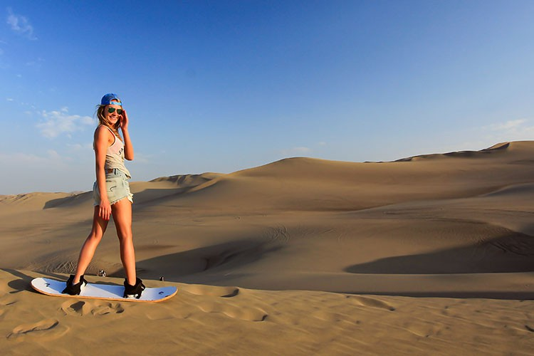 Huacachina Sandboarding at Sunset - Peru - Wanderlusters