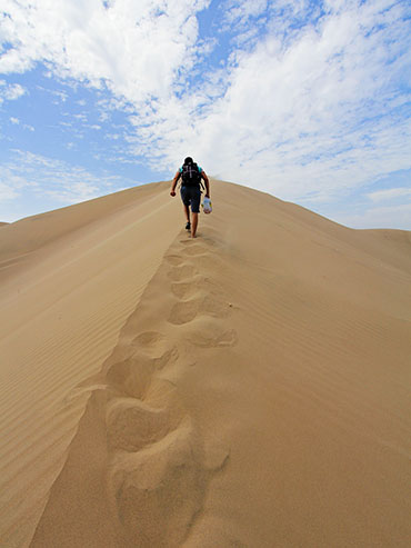 Huacachina Walking up Sand Dunes - Peru - Wanderlusters