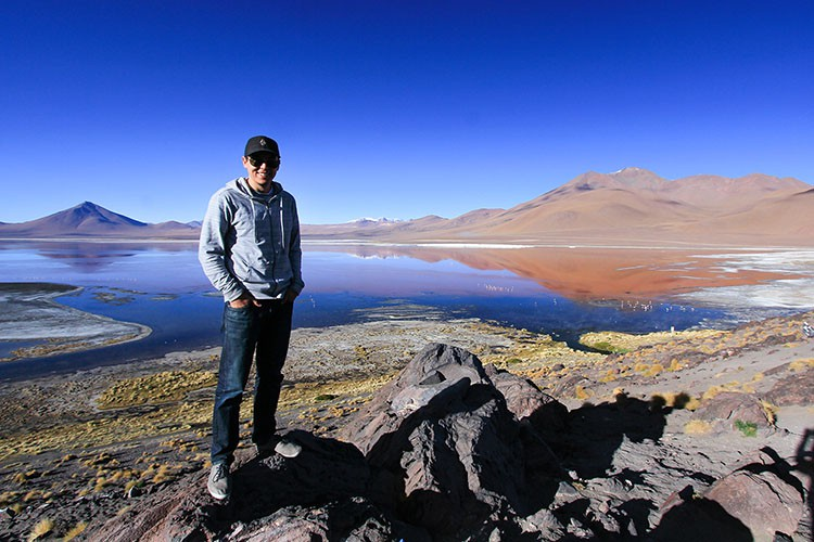 Shane at Red Lagoon - Bolivia Salt Flats Tour - Wanderlusters