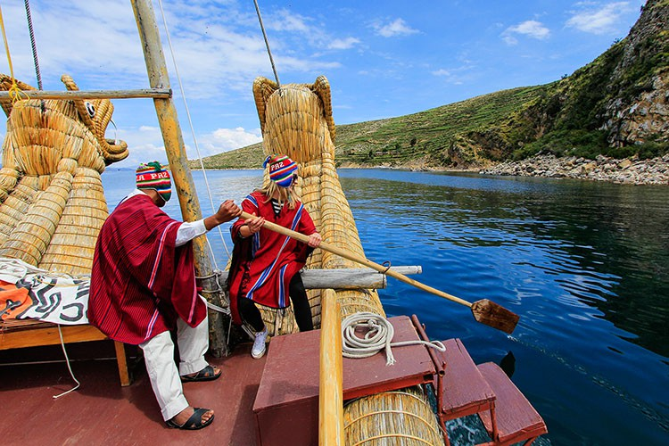 Steering a Reed Boat - Lake Titicaca Bolivia - Wanderlusters