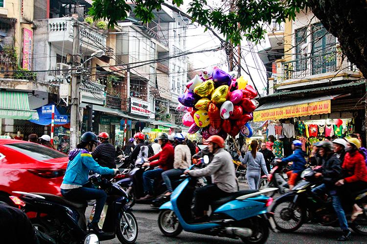 Balloons on Streets of Hanoi - Vietnam - Wanderlusters