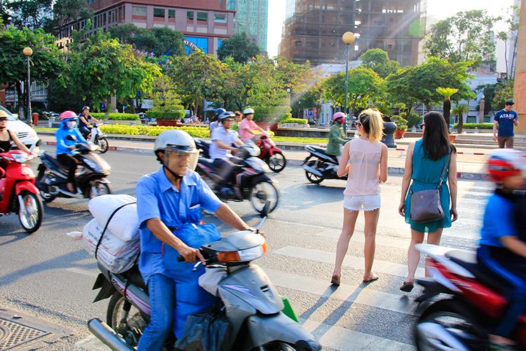 Crossing the Street in Vietnam - Saigon - Wanderlusters