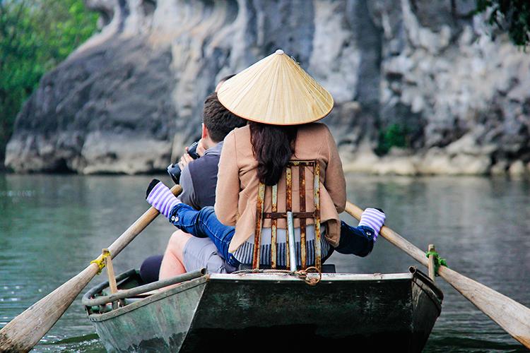 Rowing with Feet - Ninh Binh Vietnam - Wanderlusters