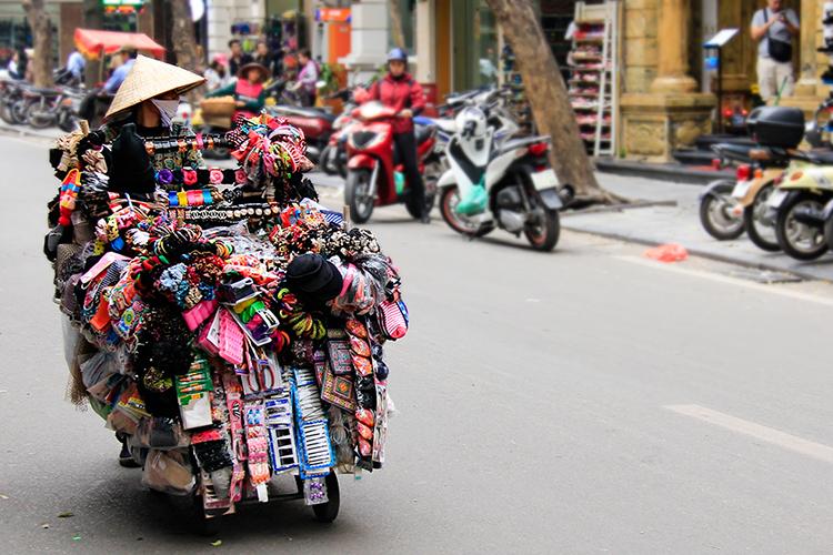 Selling Goods in Hanoi Vietnam - Wanderlusters