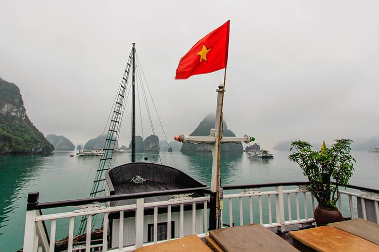 Vietnam Flag on Boat - Halong Bay - Wanderlusters